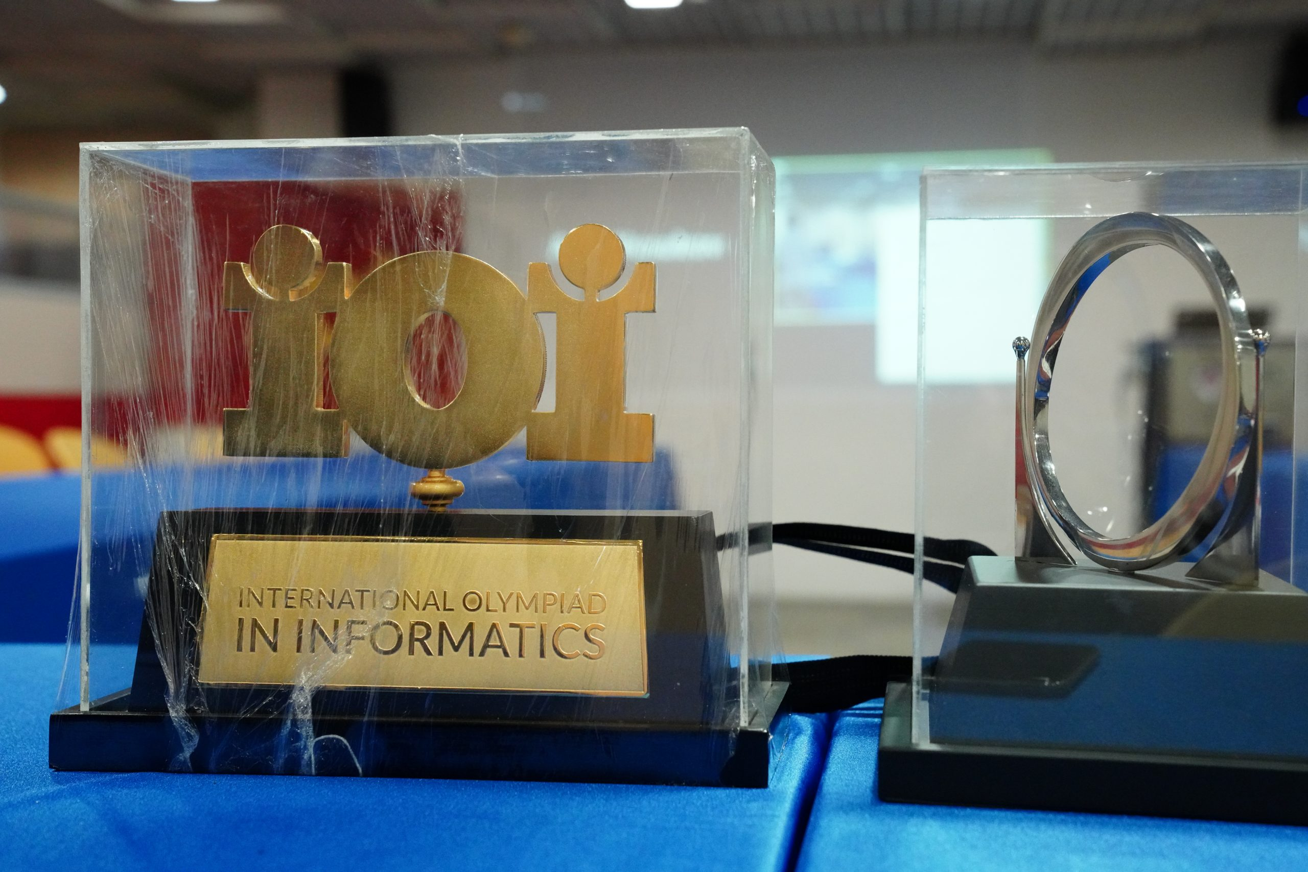 The new/left and old/right IOI trophies